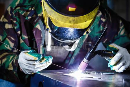 90301741-professional-welder-in-mask-welds-steel-with-electric-welding-torch-tool-factory-worker-welding-meta.jpg