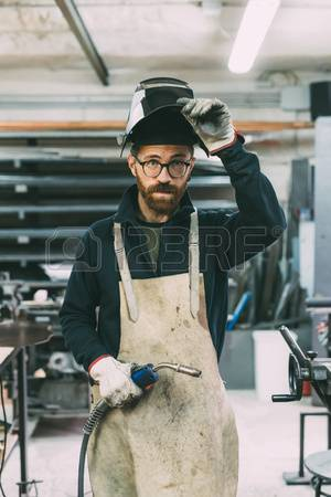 87367126-portrait-of-metalworker-holding-welding-torch-in-forge-workshop.jpg