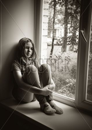 sad_little_girl_sitting_window_sill_black_white_cg1p01316113c.jpg